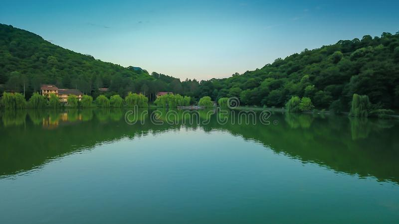 Lapota lake with green mountains reflections located in Georgia country. royalty free stock images