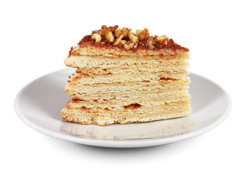Lappa av tårtan på vit pläterar arkivfoton
