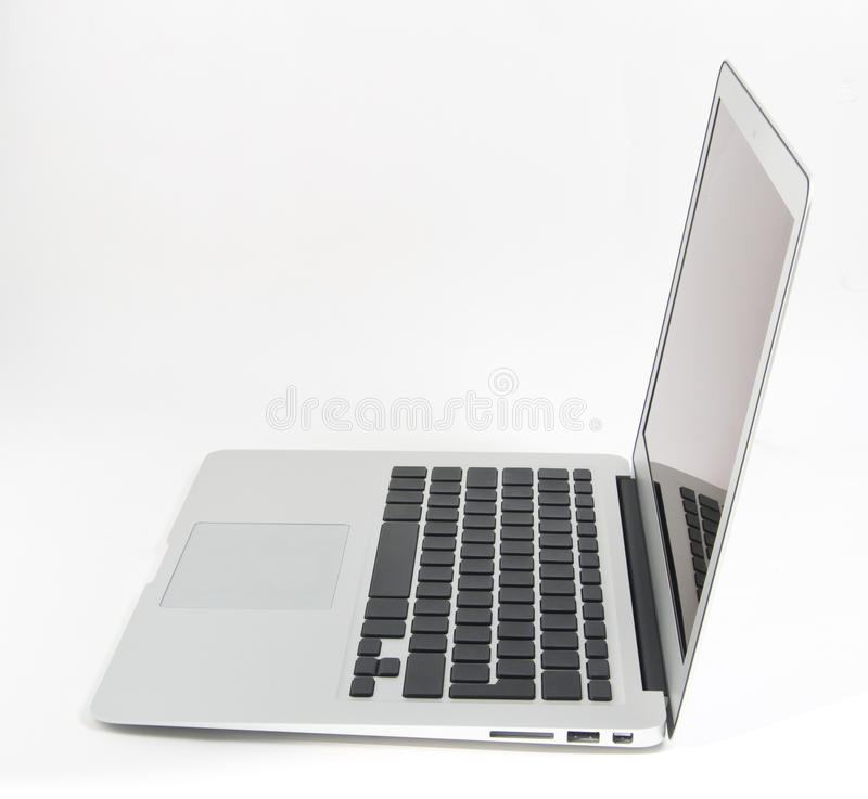 Laptop. Side view of a slim modern laptop computer on a white background