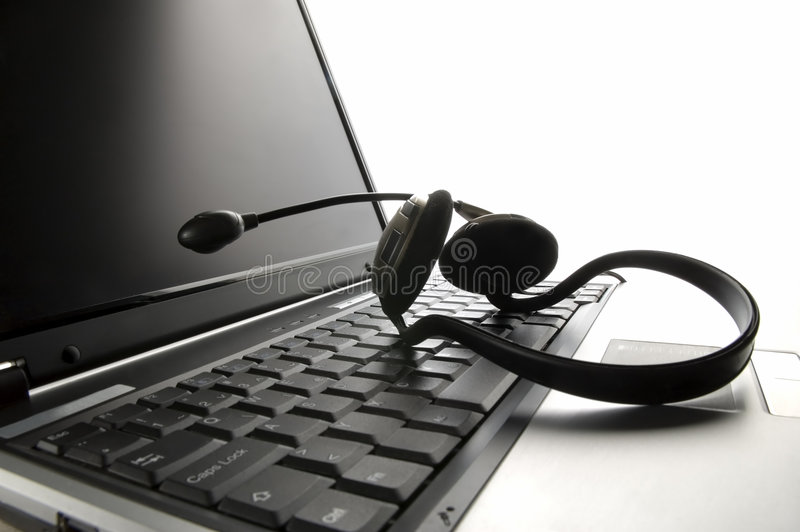 Laptop. Computer with headset close up shoot stock photo