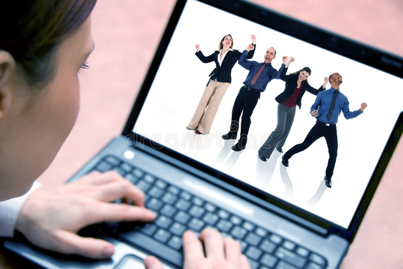 On the laptop. Business woman on her laptop with focus on face royalty free stock photography
