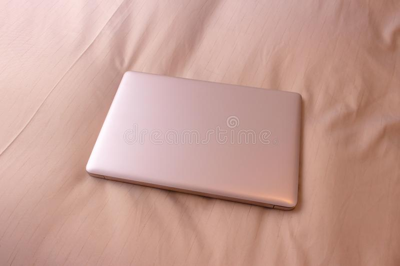 Laptop on the bed, business trip stock photography