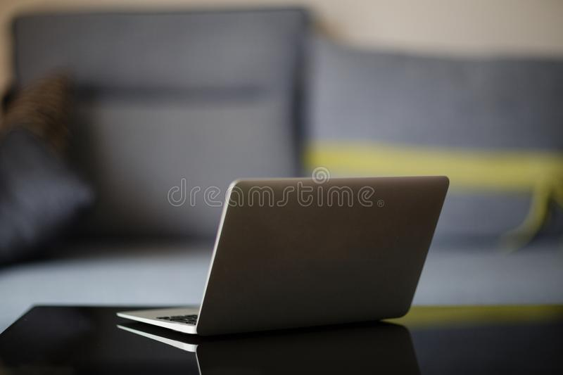 Laptop on the black desk. Working at home. Business, technology and freelance concept. Laptop on the desk. Working at home. Business, technology and freelance stock image