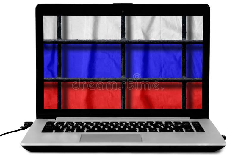 Laptop with black metal bars of a grate and a russian flag on the screen isolated on white background royalty free stock image