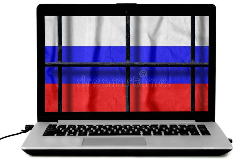 Laptop with black metal bars of a grate and a russian flag on the screen isolated on white background royalty free stock photos