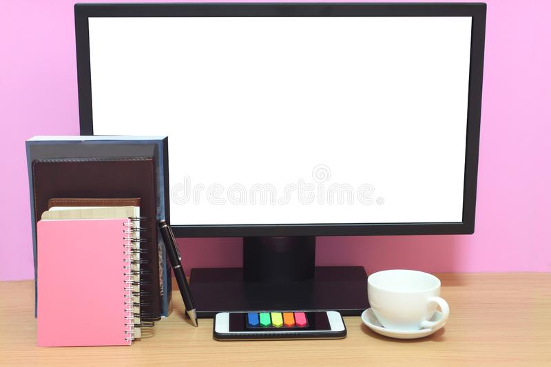 Laptop blank screen and books are placed on the desk and have co stock photography
