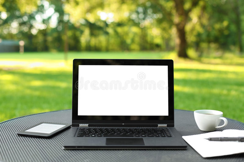 Laptop with blank screen. Outdoors