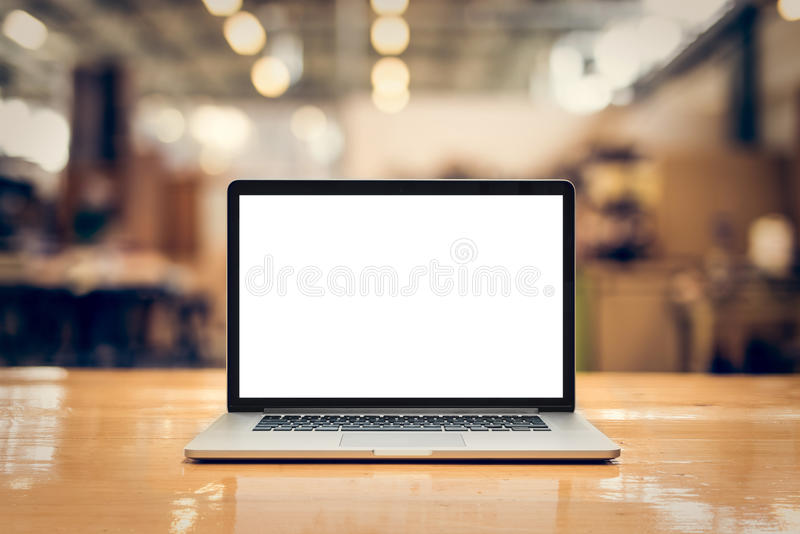 Laptop with blank screen on table - front stock image