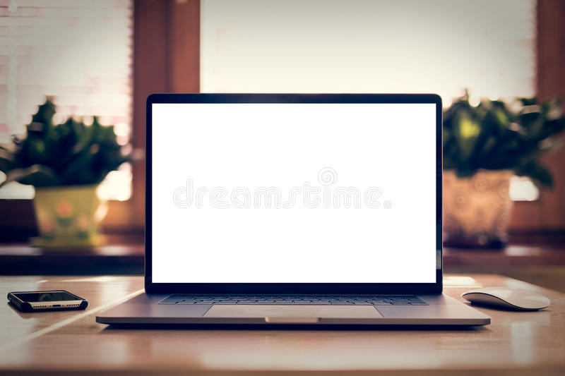 Laptop with blank screen on table. Mockup. In home interior royalty free stock photos