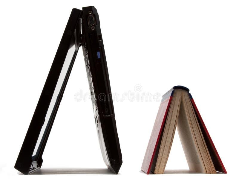 Laptop & book stock photo