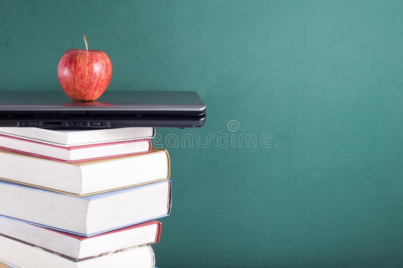 Laptop and books stock photos