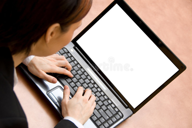 Laptop business. Cute woman on her laptop working hard stock photos
