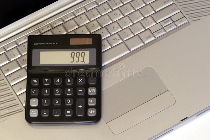 Laptop and Calculator royalty free stock photography