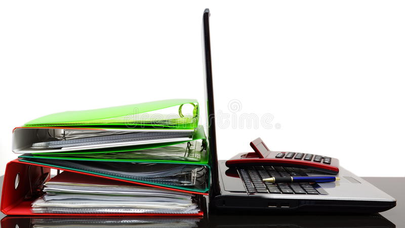 Laptop with calculator and company documentation royalty free stock photos