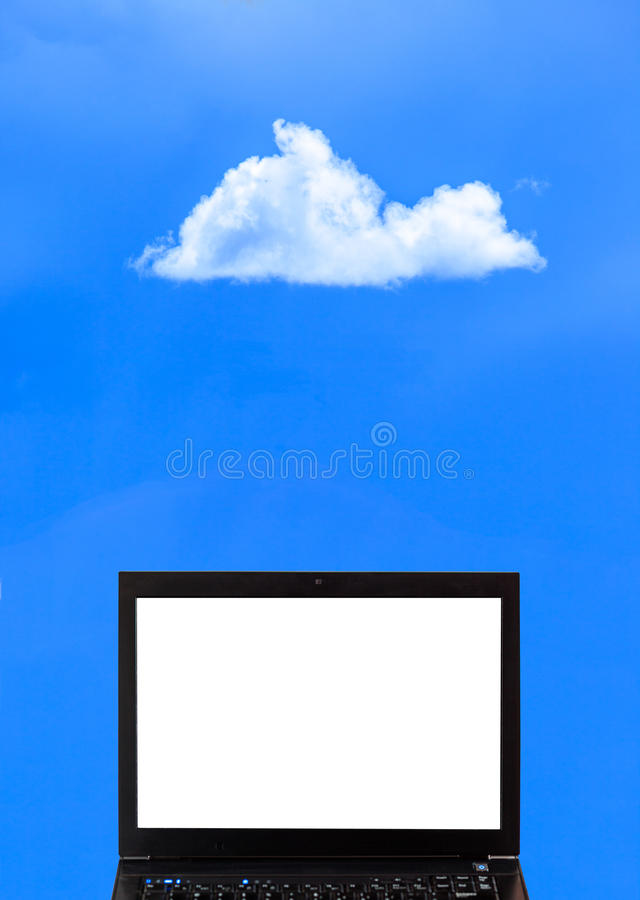 A laptop with clouds - Cloud computing royalty free stock photo