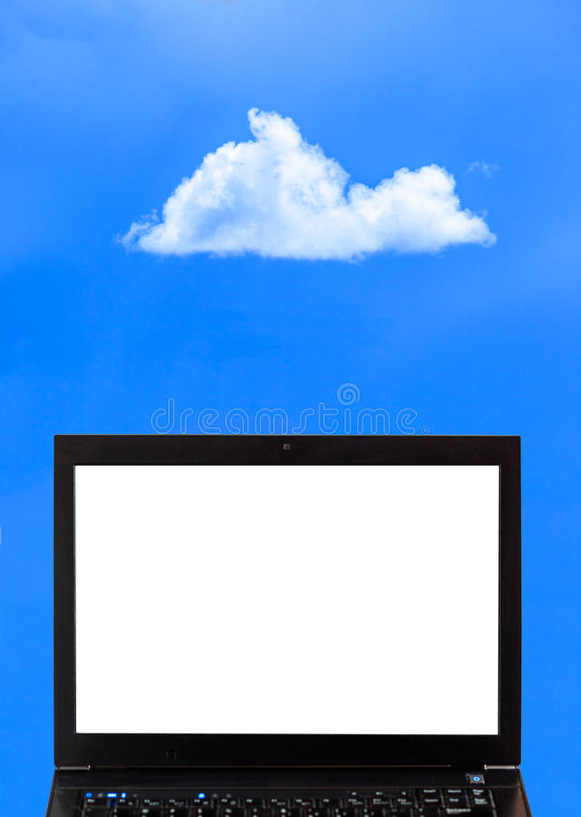 A laptop with clouds - Cloud computing royalty free stock image