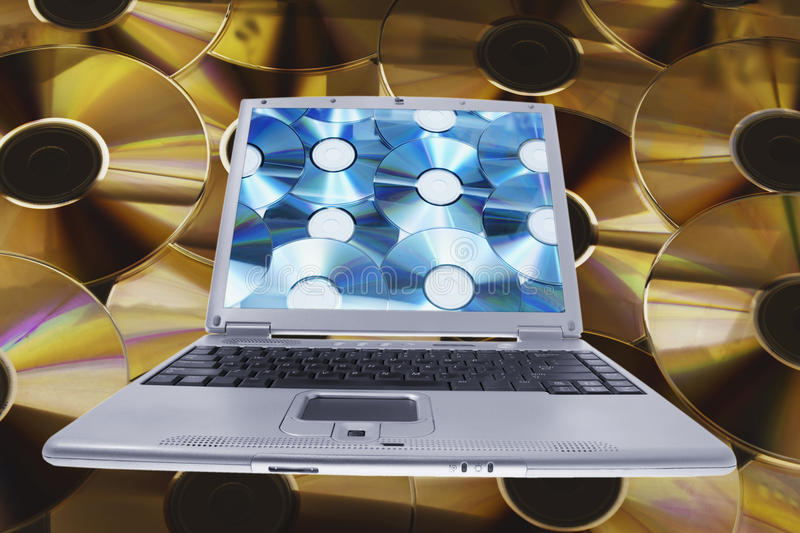 Laptop and Compact Discs royalty free stock images