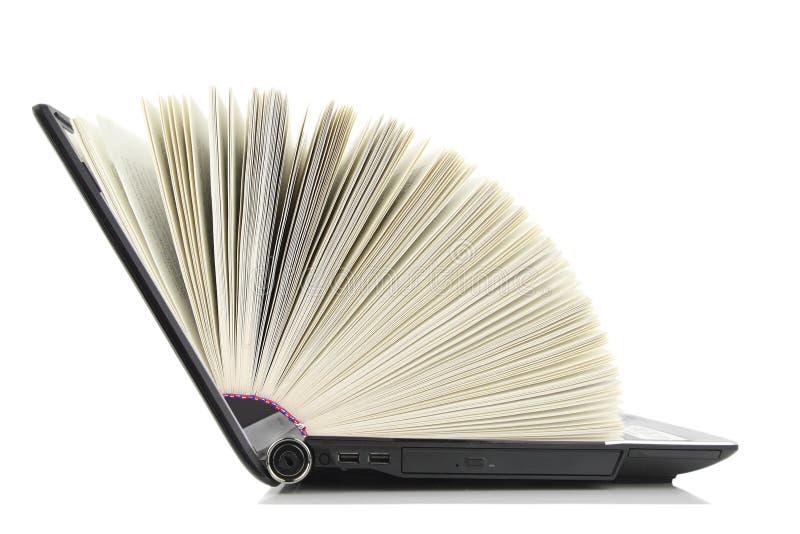 Laptop computer als Boek stock foto's