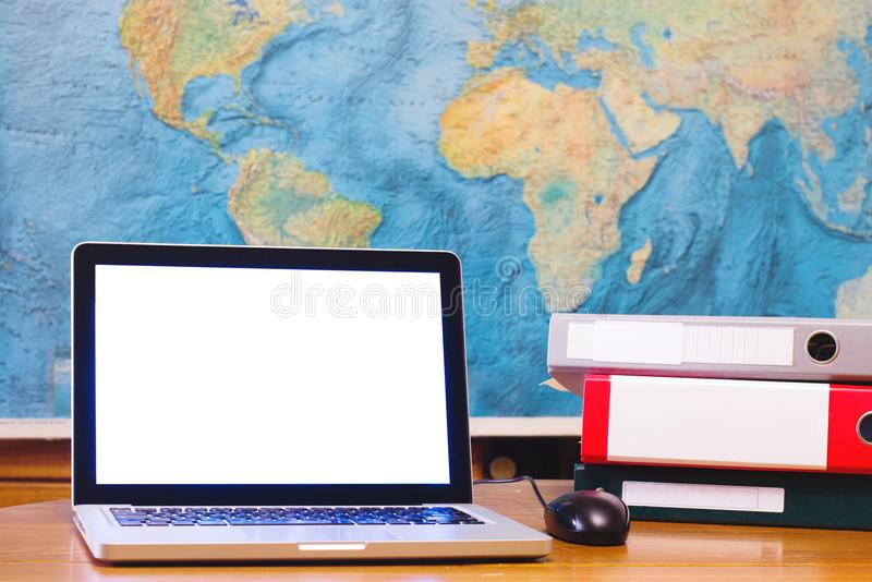 Laptop computer with blank empty screen on world map background stock photography
