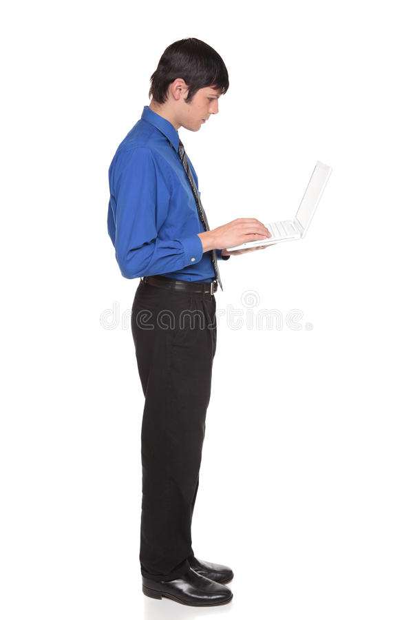 Laptop computer - businessman standing and typing stock photos