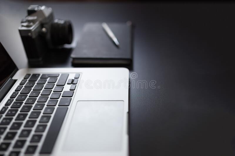 Laptop computer and camera royalty free stock image