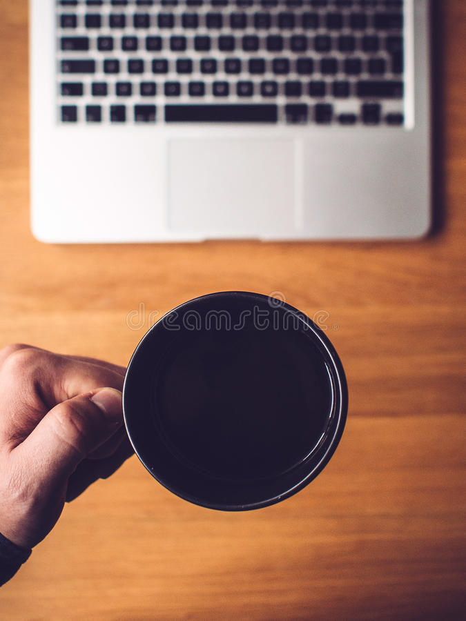 Laptop computer and coffee mug royalty free stock images
