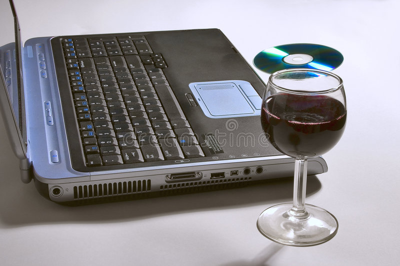 Download Laptop Computer With A Glass Of Wine And CD. Stock Image - Image of alcohol, pleasure: 46757