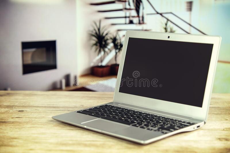 Laptop computer on home table royalty free stock photos