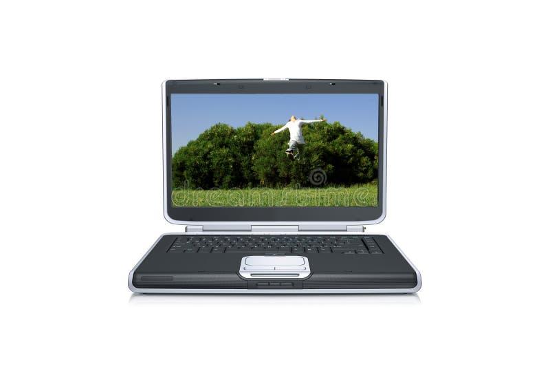 Laptop-Computer mit dem Mädchenspringen lizenzfreie stockfotos