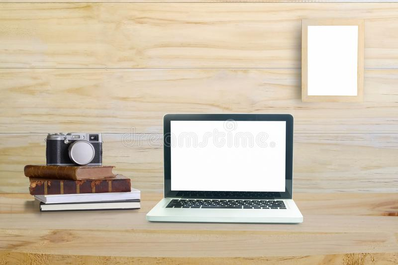 Laptop computer, office supplies, vintage book and camera. stock photography