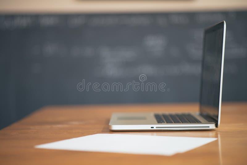 Laptop computer on school desk stock photography