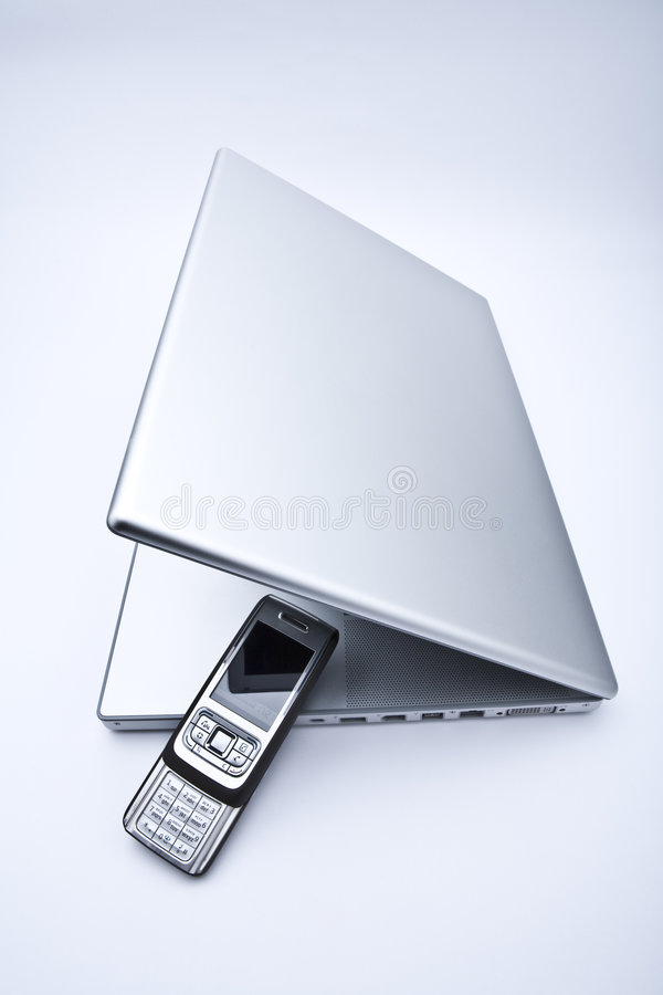 Free Laptop Computer With Cell Phone Stock Image - 4446301