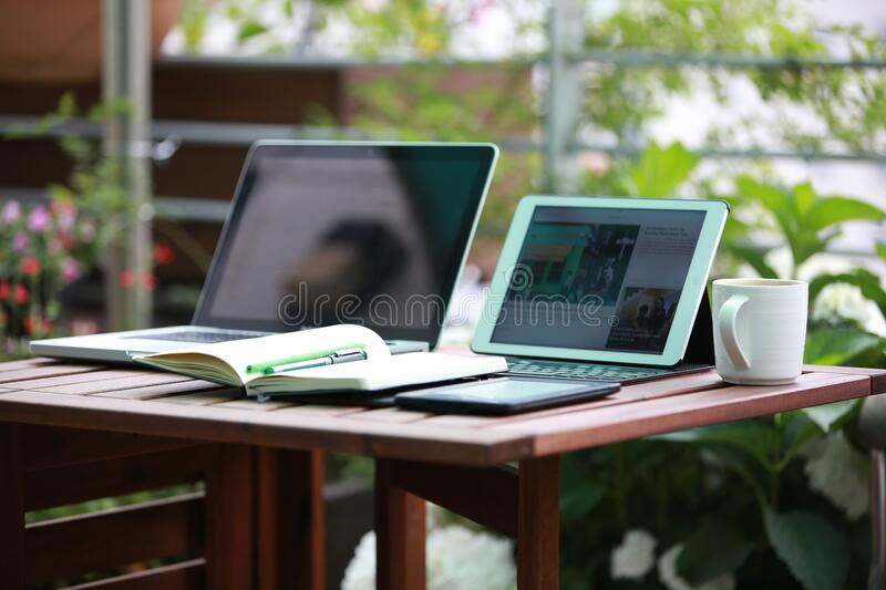 Laptop computers on wooden table royalty free stock photography
