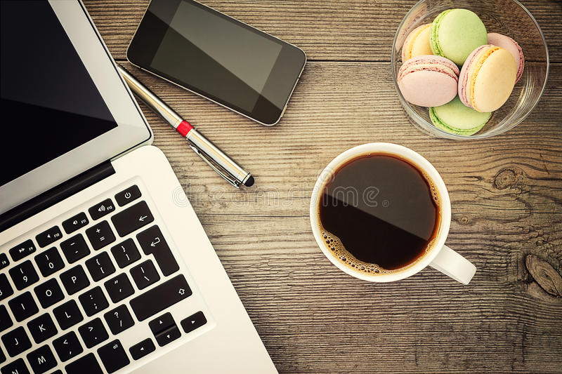 Laptop, cup of coffee and cookies royalty free stock photography