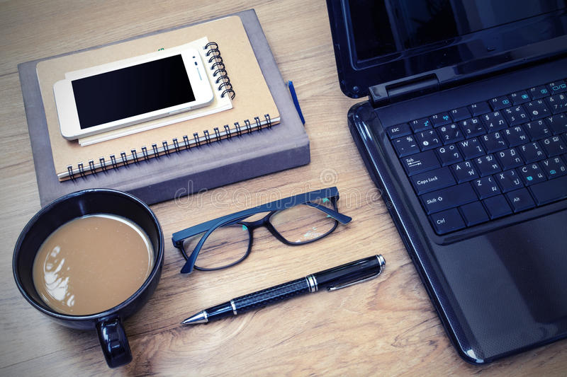 Laptop and cup of coffee with flower on desk. Vinatge style stock photos