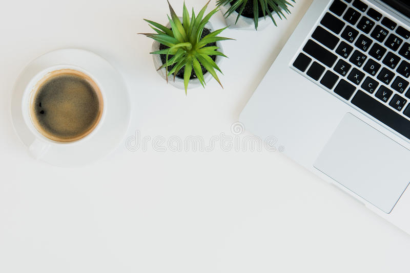 Download Laptop With Cup Of Coffee And Plants On Table Top. Laptop Desk  Coffee Stock