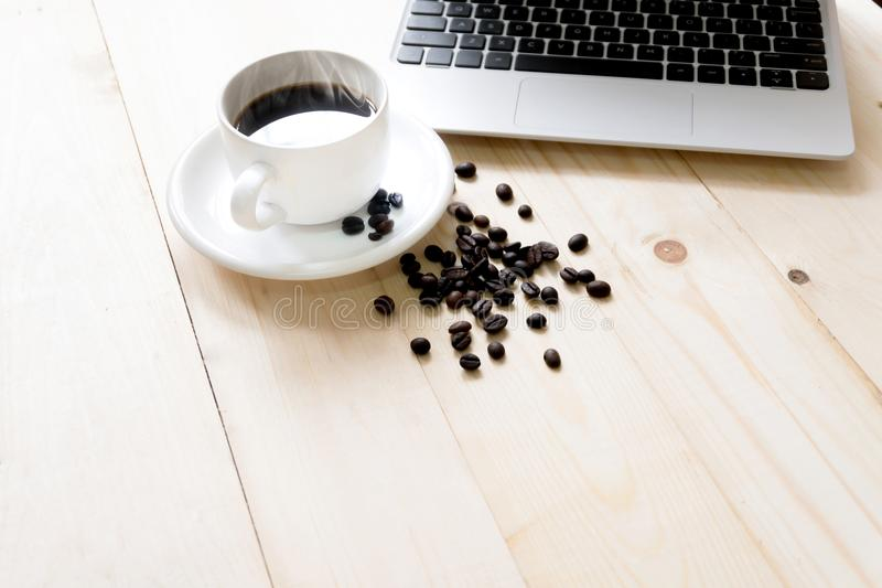 Laptop, cup of fresh coffee and coffee stock images