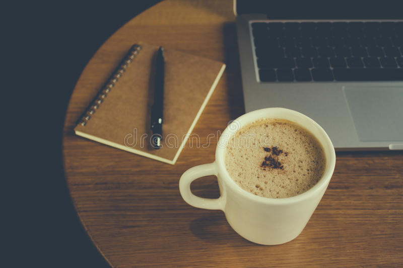Laptop with cup of fresh coffee stock photos