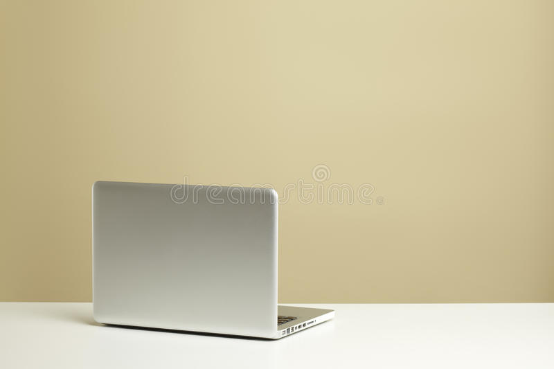 Laptop on desk royalty free stock photos