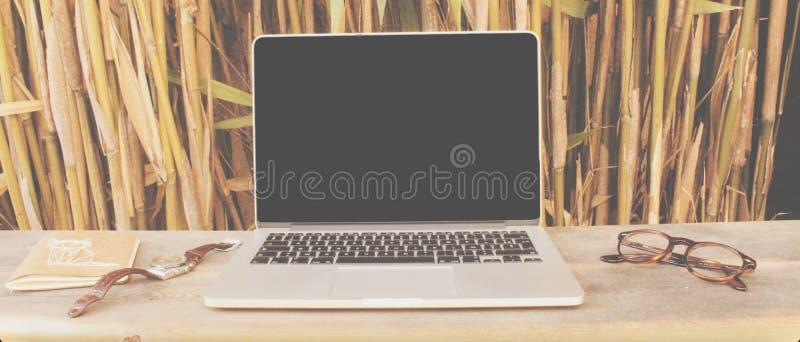 Laptop on desk royalty free stock photography