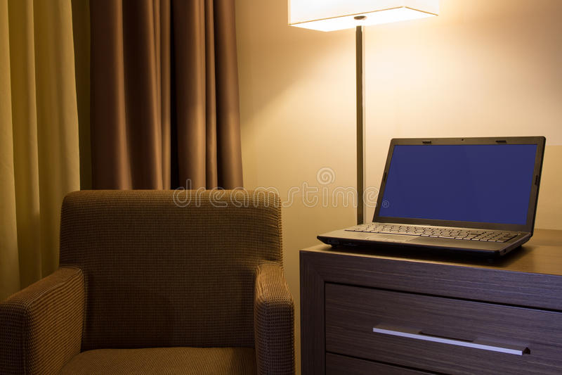 Laptop on desk in hotel room royalty free stock photo