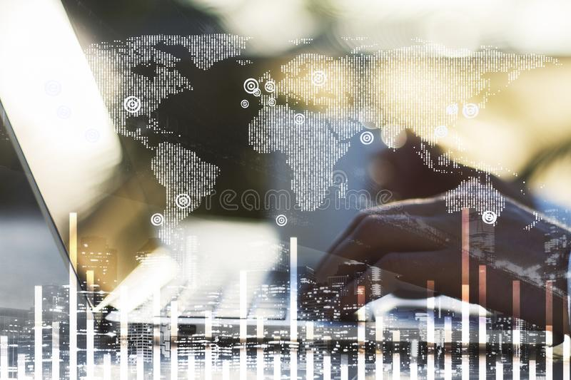 Laptop and digital world map with financial chart. Double exposure with hands on laptop at blured background and digital financial chart with world map stock photo
