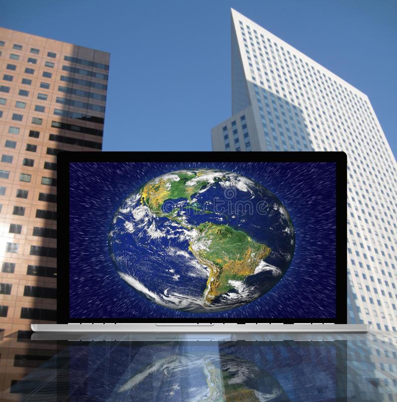 Laptop with earth stock illustration