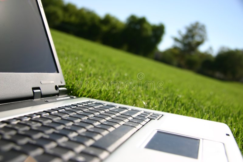 Laptop in a field royalty free stock images