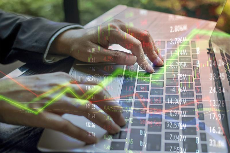 Laptop for finance use and stock trading with market charts over. Lay. Confusion and trade strategy unpredictable. Red and green rise and fall stock image