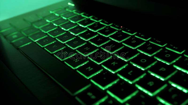 Laptop Gamming Keyboard with green lights. Laptop Gamming Keyboard with green lights, modern computer neon lights royalty free stock photo