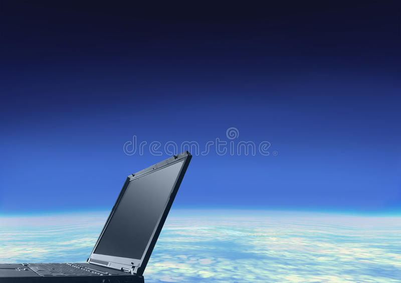 LAPTOP and GLOBE. Laptop computer with globe emerging from the screen stock image