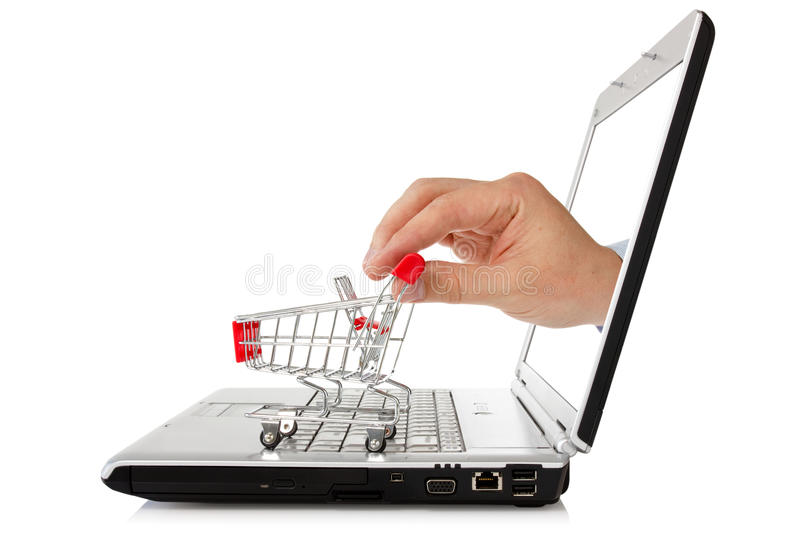 Laptop And Hand With Shopping Cart Stock Image