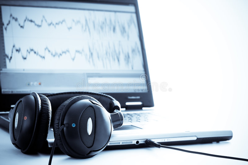 Laptop with headphones royalty free stock photo