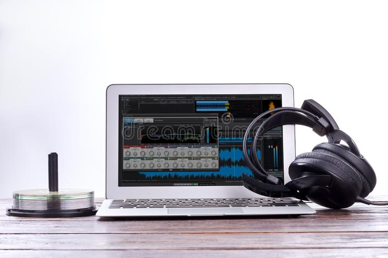 Laptop, headphones and disks. stock image